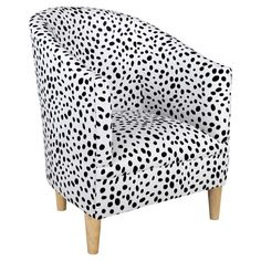 Paint splotches or Dalmatian's spots? Whatever you're seeing in the this delightfully dotted arm chair, it's surely chic. Add a bright pillow for a colorful ...