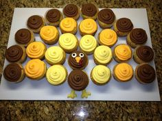 Turkey cupcake display. Use India Tree natural dyes to make yellow and orange frosting. http://feingoldrecipes.blogspot.com/2012/06/chocolate-frosting.html