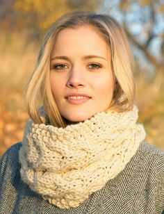 Chunky Cable Cowl. Seed stitch surrounds rich, textured horseshoe cables.  Yarnspirations