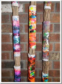 take a paper towel tube- add one paper towel to it.  Roll in paint (children have squirted into a box, lid, or  tray.  Let dry.  Make many rolls for children love this experience.