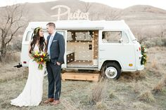 Couple in front of photo booth bus