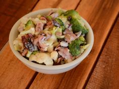 Fresh broccoli and cauliflower are mixed with raisins and sunflower seeds in a creamy dressing to make a side salad that will have everyone requesting the recipe. | CDKitchen.com
