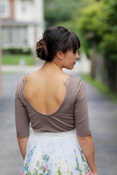 i love the back of this top and skirt.  and her tats peaking out are awesome too. :)