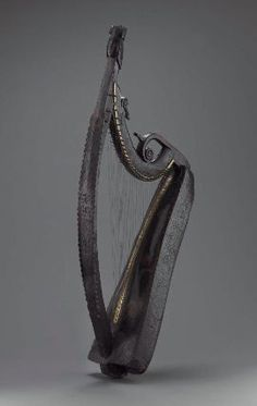 The Bunworth harp.Sides and soundboard were carved from a single block of willow and incised with scrolling foliage and flowers. Black, red, and white painted decoration. Made in 1734 by John Kelly, for Rev. Charles Bunworth, Ireland.