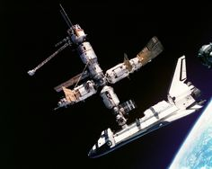 "rhubarbes: "" Atlantis Docked to Mir by NASA on The Commons Via Flickr : This view of the Space Shuttle Atlantis still connected to Russia's Mir Space Station was photographed by the Mir-19 crew on July 4, 1995. Cosmonauts Anatoliy Y. Solovyev and..."