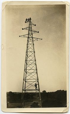 men on radio tower / pylon