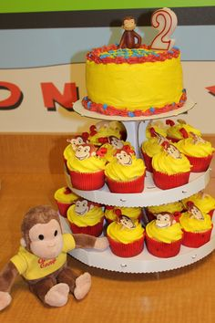 Curious George Cupcake tower. love it! can make him a separate small cake that's everything free, and make regular cupcakes for everyone else.