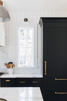 Kitchen - Cabinets Onyx by Benjamin Moore Trim and Shiplap Simply White by Benjamin Moore