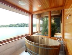 Contemporary master bathing suite with wooden tub designed by James Cleary Architecture.