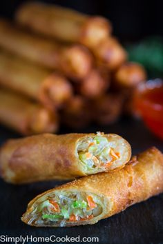My mother's coworker from china shared this amazing spring roll recipe with us and we fell in love with it. We used to make these rolls using egg roll wrappers but after discovering spring roll wrappers we can't go back. The crunchy texture of fried spring rolls can't compare to egg rolls. I personally think