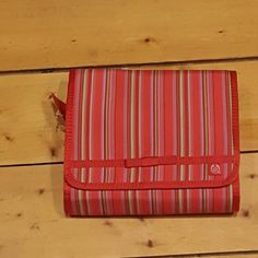 The Body Shop beauty organizer red NEW New from the Body Shop beauty organiser for the party jet set. This is a trifold with three detachable pockets. It is red with green, white, purple pinks stripes. Please contact me with any questions The Body Shop Bags Cosmetic Bags & Cases