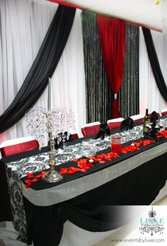 Red black and white wedding backdrop and head table