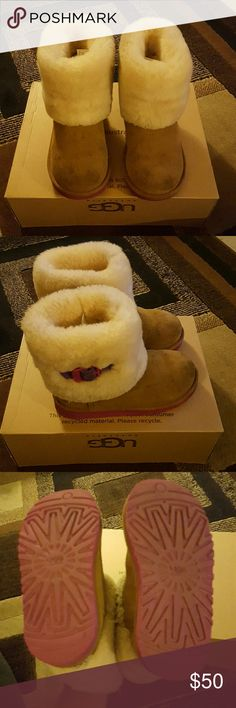 Kids Ugg boots!!! Kids Ugg boots. Slightly worn, small stains nothing the Ugg kit can't fix. UGG Shoes Boots