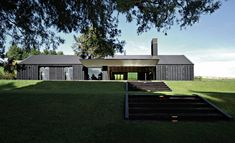 McKinney + Windeatt Architects look at exterior photos heavy timbers painted/stained black, black stone but white interiors Modern Barn House, Contemporary Barn, Casas Containers, Long House, Gable Roof, Shed Homes, House Roof, The Ranch, Black House