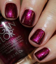 Morgan Taylor Wrapped In Glamour Holiday 2016 | Vampy Varnish / You're So Elf-Centered! is a deep maroon purple shimmer