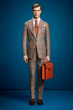 I love this Gucci plaid suit because it shows class but also a touch of style.