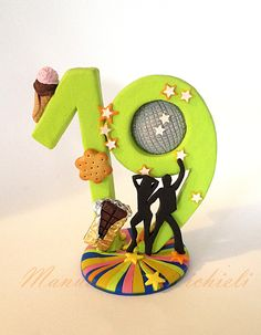 Polymer Clay cake topper celebrating a 19 years old girl who loves sweets and disco dancing - by Manuela P. Michieli