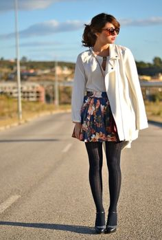 Shop this look on Lookastic:  http://lookastic.com/women/looks/sunglasses-peasant-blouse-coat-skater-skirt-tights-pumps/5056  — Brown Leopard Sunglasses  — White Peasant Blouse  — White Coat  — Navy Floral Skater Skirt  — Navy Tights  — Black Leather Pumps