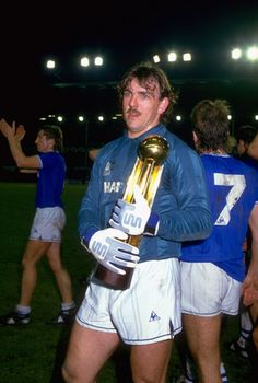 Here's legendary Everton goalkeeper Neville Southall holding the 1985 European Cup Winners' Cup. He looks shell-shocked, but his mustache is calm and composed. Football Program, Football Kits, Football Soccer, Football Players, Wales Football, Retro Football, World Football, School Football, Movember Mustache