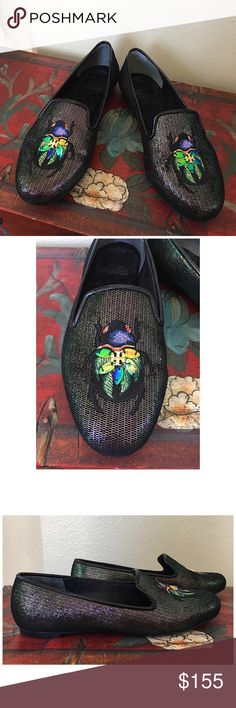 """TORY BURCH CAILYN BEETLE SMOKING SLIPPER Very gently worn Tory Burch Caitlyn Smoking Slipper.  So cute. Woven with iridescent metallic lurex threads and accented with sequins. * Iridescent leather & patent upper. * Mesticolin lining. * Leather sole with embossed logo. * Embroidered scarab patch withmetalTory logo. * Heel height: .25"""" * Length: 9.75"""" (measured inside toe to heel). ▶️COMES WITH ORIGINAL BOX, SORRY NO DUSTBAG◀️ ALL MEASUREMENTS ARE APPROXIMATE Tory Burch Shoes Flats & Loafers"""