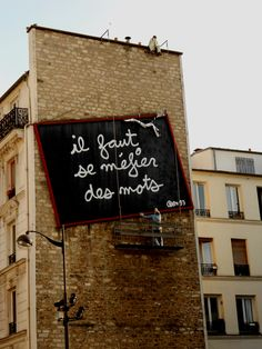 """Ben Vautier - Bellevile """"you should be wary of words"""" Street Signs, Wall Street, Street Art Quotes, Explanation Writing, Poesia Visual, Creative Writing Classes, Quality Street, Fluxus, Graffiti Painting"""