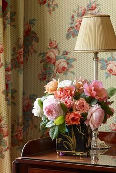 """Flower arrangement echoes """"Old Roses"""" wallpaper at Bowood House."""