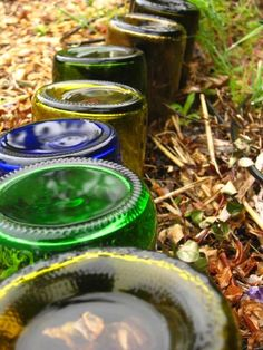 Use #recycled wine bottles as edging for your flower beds #homesfornature