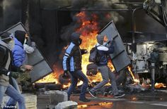 Anti-government protesters in a violent clash with police in central Kiev on Tuesday, a day after Moscow moved to cement its influence over Ukraine with $2 billion in cash to shore up the former Soviet state's heavily indebted economy