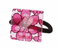 """France Luxe Mod Pony - Mantilla Fuchsia by France Luxe. $5.90. Made in France. Soft plush ponytail holder won't break your hair. Available in a variety of colors. Dimensions: 1.5"""" x 1.5"""". Luxury shine and finish. The France Luxe Mod Pony - Mantilla, provides a classic solution to dress up your ponytail from the ordinary banded look. This simple shaped square with its beautiful luster and finish will spice up your ponytail with just the perfect amount of style."""