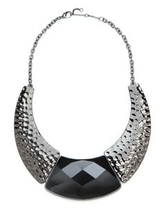 We're absolutely mad for this audacious statement necklace. With its bold crescent silhouette, hammered gold motif and massive hunk of faceted onyx, the look is pure glamour.