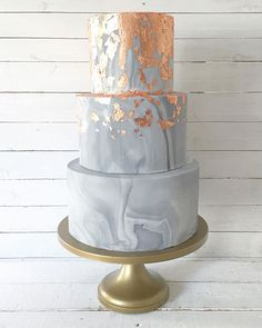 Grey marble and copper on top tier wedding cake #copper #marbleweddingcake #weddingcake #weddingcaketrends