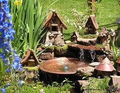 fairy garden with water feature! I wish there was a link to more pictures of this one, but someday, I will have a little pond with fairy houses tucked around it! Mini Fairy Garden, Fairy Garden Houses, Gnome Garden, Dream Garden, Fairy Village, Gnome Village, Pot Jardin, Water Features In The Garden, Fairy Doors