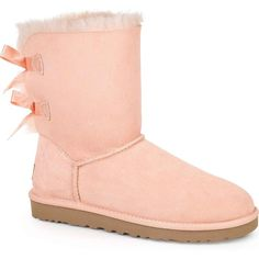 UGG Australia Women's Bailey Bow Pink Dust Boots ($205) ❤ liked on Polyvore featuring shoes, boots, zapatos, ugg, ankle boots, pink, shootie, patent leather shoes, pink shoes and bootie shoes