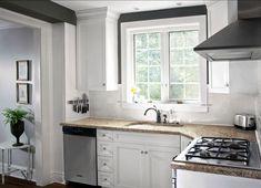 Small kitchen- backsplash goes a little above bottom of cabinets!