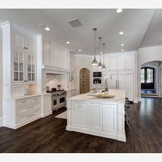 The dark hardwood floors and white cabinets create a beautiful balance in this kitchen by Simmons Estate Homes. QUESTION: if you had the choice, would you have tile or wood floors in your kitchen?... - Interior Design Ideas, Interior Decor and Designs, Home Design Inspiration, Room Design Ideas, Interior Decorating, Furniture And Accessories
