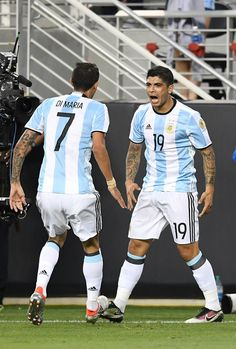 Ever Banega Photos Photos - Ever Banega #19 and Angel Di Maria #7 of Argentina celebrates after Banega scored a goal against Chile during the 2016 Copa America Centenario Group match play between Argentina and Chile at Levi's Stadium on June 6, 2016 in Santa Clara, California. - Argentina v Chile: Group D - Copa America Centenario