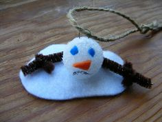 DIY Melted Snowman Ornaments--Easy craft for kids to make. Includes instructions. Use smooth foam balls rather than styrofoam balls for a more realistic look. You can use a Sharpie to draw the face.