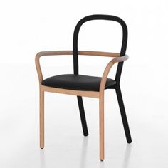 Gentle by Front for Porro - The flexible back of this chair by Swedish designers Front comprises a thick spring wrapped in black leather.