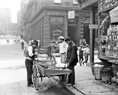 Clam Seller New York City 1900, worker, vintage, street view, city, history, photo b/w.