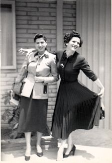 Long Skirts with buttoned up shirts came along with high heels. They were normally worn with gloves and large hats.