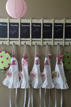Monogrammed aprons for cupcake decorating party