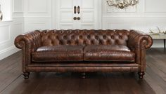 Dark Brown Leather Chesterfield Sofa And Light Walnut Wood Flooring
