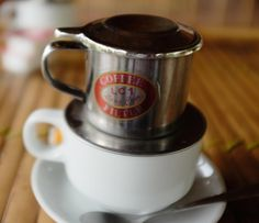 A guide to Vietnamese coffee - Coffee filters through a phin atop a coffee cup Egg Coffee, Coffee Uses, Coffee Type, Black Coffee, Coffee Beans, Iced Coffee, Planet Coffee, Lao, Coffee Shake