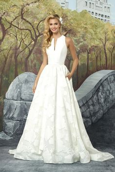 132fabcee1 Feel elegant with this structured sleeveless Mikado ball gown with  structured notch collar. The organza