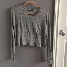 Brandy Melville Cropped Sweater Adorable cropped Brandy sweater, tags removed but never worn. Very soft and comfortable material, still perfect condition. Brandy Melville Sweaters Crew & Scoop Necks