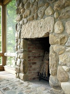 beautiful stone fireplace on the porch