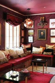 I love this  window seat! Red wall coverings, painted ceiling, upholstered seating