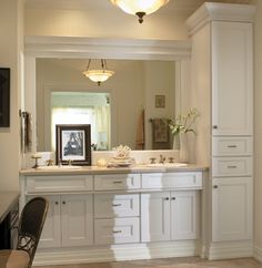 Bath Vanity And Tall Linen Closet From Medallion Cabinetry. Shown In Maple  White Icing Classic Paint On Piccadilly Door Style.