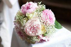 wedding bouquet of peonies, roses and gypsophila