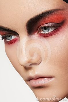 Fashion model face with devil halloween make-up by Seprimoris, via Dreamstime